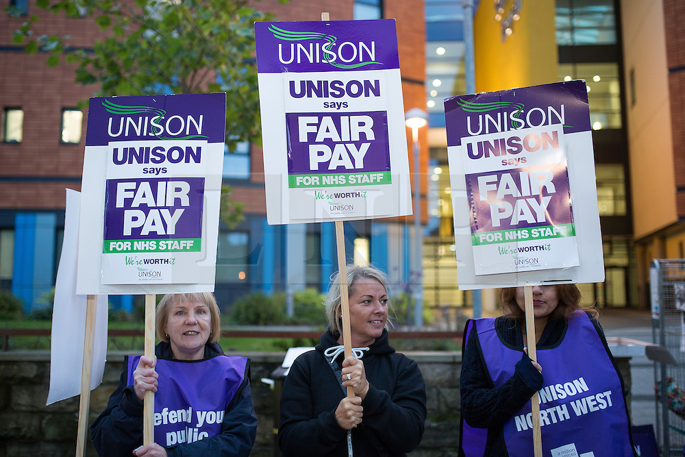 "© Licensed to London News Pictures . 13/10/2014 . Salford , UK . NHS staff picket outside the Salford Royal (formerly "" Hope "") Hospital in Greater Manchester as nurses, midwives and ambulance staff stage a four hour strike over pay .  Photo credit : Joel Goodman/LNP"
