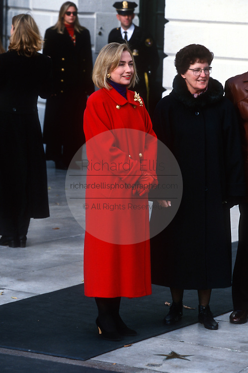 First lady Hillary Clinton waits for the the arrival of the White House Christmas tree November 27, 1996 in Washington, DC. The National Christmas Tree Association presented Mrs. Clinton with the tree, an 18 1/2-foot Colorado Blue Spruce, grown in Coshocton, Ohio, which will grace the White House Blue Room during the Christmas season.
