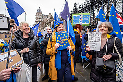 © Licensed to London News Pictures. 30/01/2020. London, UK. Remainers fly European flags on Parliament Square on the last day before Brexit which will happen at 11pm on 31st January 2020. They have organised a Remainers vigil later tonight on Parliament Square. Photo credit: Alex Lentati/LNP