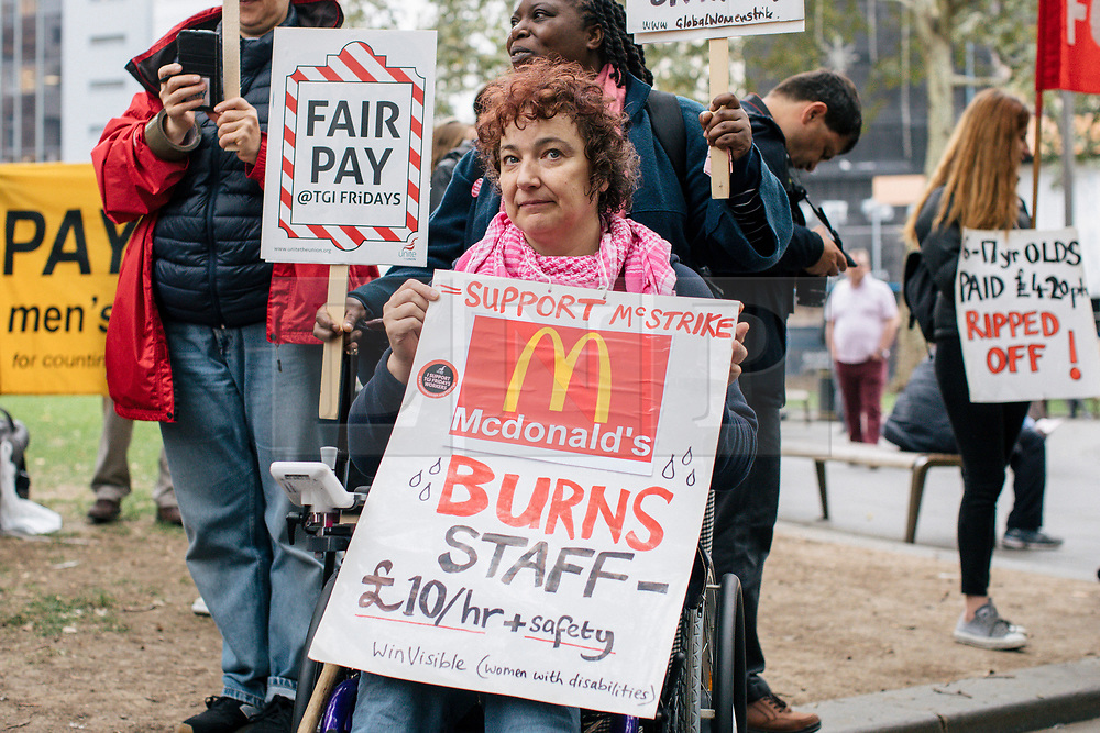© Licensed to London News Pictures. 04/10/2018. London, UK. Supporters of striking fast food workers at a rally in Leicester Square as part of strike action over pay. UberEats, JD Wetherspoon, McDonald's and TGI Fridays workers are among those taking part. Photo credit: Rob Pinney/LNP
