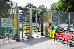 London, UK. 1 June, 2019. A turnstile in a large fence around Winfield House, residence of the US ambassador to the UK, forms part of a large Metropolitan Police security operation being implemented in advance of the state visit of President Trump.