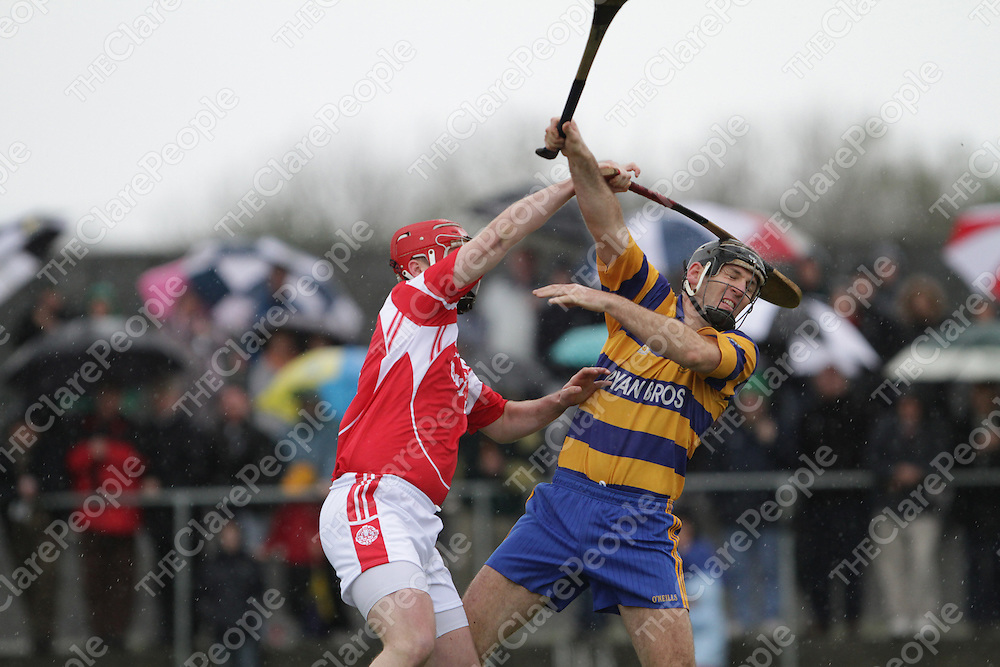 Eire &Oacute;g's Barry Nugent wins his aerial battle for possession with Ruan's Niall O'Connor to score to games only goal.<br /> Photograph by Flann Howard