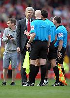 Arsene Wenger Manager complains to Referee Andre Marriner after the final whistle<br />Arsenal 2010/11<br />Arsenal V Liverpool (1-1) 17/04/11<br />The Premier League<br />Photo: Robin Parker Fotosports International