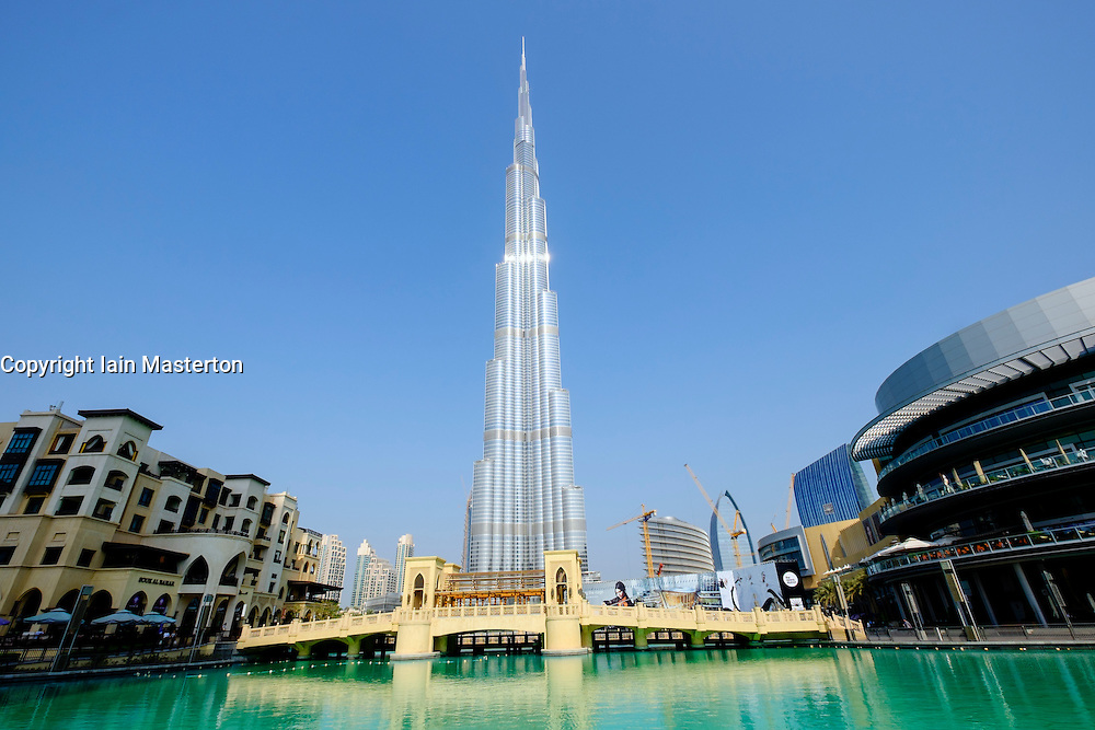 Burj Khalifa tower and Dubai Mall next to pond  in Downtown Dubai United Arab Emirates