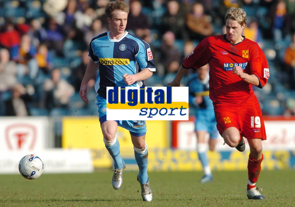 Photo: Leigh Quinnell.<br /> Wycombe Wanderers v Shrewsbury Town. Coca Cola League 2. 11/03/2006. Wycombes Dean Bowditch shakes off Shrewsburys David Edwards.