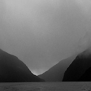 Milford Sound, South Island, New Zealand...You would be forgiven for thinking you'd just stepped out of a time machine while travelling around the South Island of New Zealand.. From the misty shades of grey in the fiord of Doubtful Sound, to the fully operational Steamboat the TSS Earnslaw; the Lady of the Lake on Lake Wakitepo, this beautiful island is a Tardis for tourists!..The South Island of New Zealand is roughly the size of England, but it's population of less than a million people means much of the land remains free from human development. It's breathtaking views, and it's climate, could be likened to a cross between Scotland and Scandinavia, and around every corner is mostly unspoilt natural beauty....The Commercialised resort town of Queenstown is the nerve centre of the islands tourism industry, providing the more adventurous thrill seeker with jet boating, skydiving, bungy jumping, and paragliding to name just a few of the more adventurous activities..Queenstown also provides numerous Lord of the Rings tours into middle earth.. In stark contrast the TSS Earnslaw, The Vintage Steamship which has graced the waters of Lake Wakatipu since 1912 provides daily voyages to Walters Peak and a step back in time for it's passengers. The voyage even includes a good old fashion sing-a-long to songs of yesteryear...Just forty five minutes out of Queenstown the Kingston Flyer, a vintage steam train still operates on 14km of track using two AB Pacific Class steam locomotives built in 1925 and 1927 respectively, although the Flyer's history began much earlier in 1878 when it operated between the main south line and Gore..Fijordland on the south Western side of the Island has some of the world's greatest treks; indeed the Milford Track is often booked up way in advance...