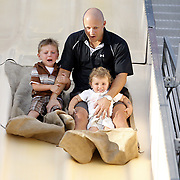 Port Chester, NY / 2008 - Stefan and Isabella Madaffari tightly hold on to their father Stephan Madaffari while on the Fun Slide ride at the Church of Corpus Christi annual summer festival in Port Chester. ( Mike Roy / The Journal News )