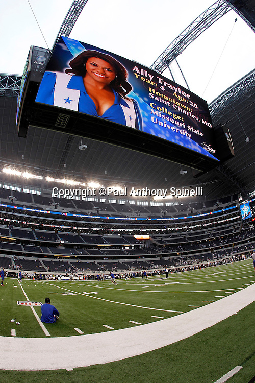 A Dallas Cowboys cheerleader is featured on the large video monitor hovering over the field during the NFL week 7 football game against the New York Giants on Monday, October 25, 2010 in Arlington, Texas. The Giants won the game 41-35. (©Paul Anthony Spinelli)