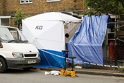 © Licensed to London News Pictures. 02/06/2018. London, UK.  Police forensic tent at the crime scene cordon in Cable Street, east London this morning. Police were called to Cable Street E1 at 17:56 on Friday 1st June to reports of a stabbing. A 22 year old male suffering from multiple stab wounds was taken to an east London hospital in a critical condition. The victim remains in a critical condition this morning.  Photo credit: Vickie Flores/LNP