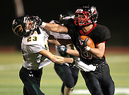 Linn-Mar's Andy Henry (8) stiff arms Kennedy's Brandom Holmes (23) after a catch during the game between Cedar Rapids Kennedy and Linn-Mar at Linn-Mar Stadium in Marion on Friday evening, September 2, 2011. It was 35-7 Linn-Mar at halftime.