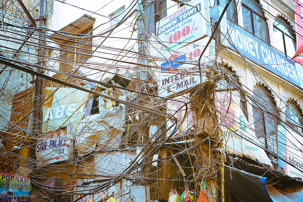 Hundreds of telephone and electricity cables are entangled outside a building in the Paharganj neibourhood of Delhi, India.