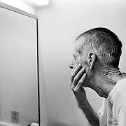 Blayne Kinart looks at himself in the mirror while in a hospital?s palliative care unit.  58-year-old Blayne Kinart a former chemical worker who died from Mesothelioma, a cancer associated with asbestos exposure in Sarnia, Ontario. Residents of the area have nicknamed Sarnia ?Chemical Valley?, due to the large number of chemical plants operating in the area. Blayne passed away on July 6, 2004.