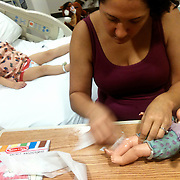 Leilani Frizzelle cleans her daughter Larue's baby doll at UNC Children's Hospital in December of 2012. On December 27, 2012 two year old Holly Larue Frizzelle was diagnosed with Acute Lymphoblastic Leukemia. What began as a stomach ache and visit to her regular pediatrician led to a hospital admission, transport to the University of North Carolina Children's Hospital, and more than two years of treatment.