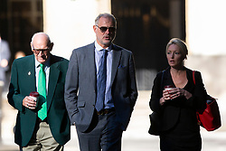 © Licensed to London News Pictures. 22/08/2019. London, UK. John Leslie (c) arrives at Southwark Crown Court. The former BBC Blue Peter presenter is expected to enter a plea in connection with a charge of sexual assault dating from 2008. Photo credit: George Cracknell Wright/LNP