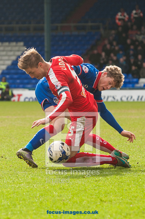 Gary Liddle of Chesterfield tackles Matt Palmer of Oldham Athletic during the Sky Bet League 1 match at Boundary Park, Oldham<br /> Picture by Matt Wilkinson/Focus Images Ltd 07814 960751<br /> 28/03/2016