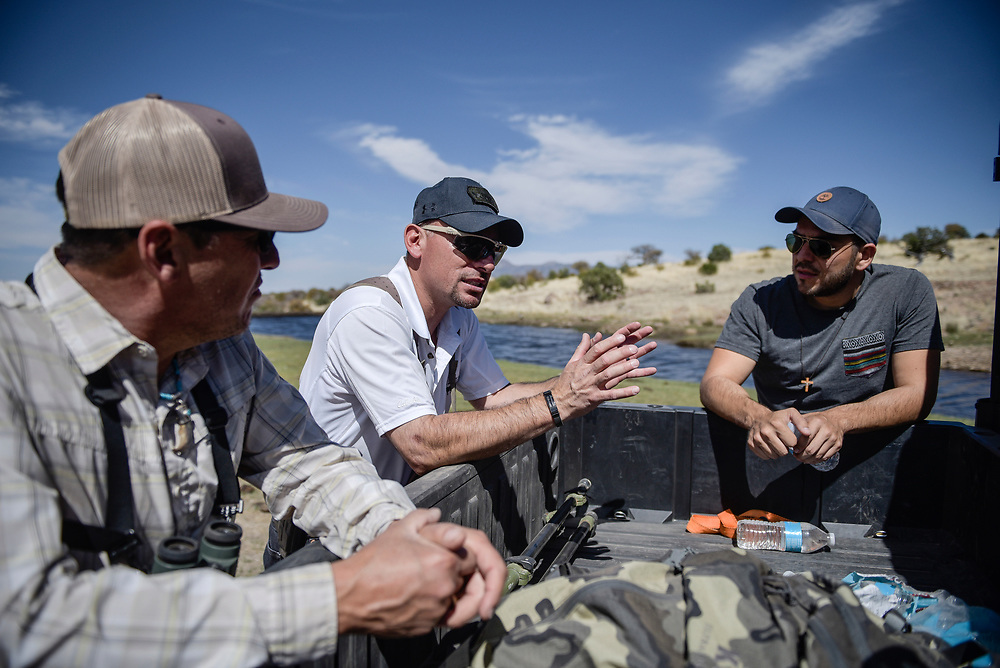 rer041417g/A1/April 14, 2017/Albuquerque Journal<br /> Story about how the proposed border wall by the Trump administration would have on the ecosystem throughout New Mexico's Coronado National Forest. Pictured from left to right are Deming Public Schools assistant superintendent and avid sport man Ray Trejo(Cq), wildlife biologist Fernando Clemente(cq), Gabe Vasquez(Cq), southern New Mexico coordinator for the wildlife federation, as they discuss the effect of the wall on this environment. <br /> Roberto E. Rosales/Albuquerque Journal
