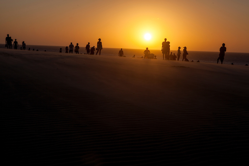 People enjoying a gorgeous sunset on the dunes at Jericoacoara, Brazil.