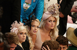 Earl Spencer's daughters, Lady Amelia, Lady Eliza and Lady Kitty wait for the wedding ceremony for  Prince William and Kate Middleton to start inside Westminster Abbey in London