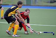 Matt Moore for Canterbury tackles Benedict Van Woerkom form Capital, National Under 21 Hockey Tournament - Day 1, 7 May 2011, Alexander McMillan Hockey Centre Dunedin, New Zealand. Photo: Richard Hood/photosport.co.nz