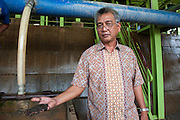 Fondy (51 years) is a contracter working for PT Timah, his mine produces 60 tons of tin a month. He hopes to be able to produce 80-100 tons next year. The Pemali mine,  the biggest legal mine in Bangka that has completely devastated the once green landscape. Operated by PT-Timah. It produces 60 tons of tin per month. Bangka Island (Indonesia) is devastated by illegal tin mines. The demand for tin has increased due to its use in smart phones and tablets.<br /> <br /> <br /> Fondy (51 ans) est un sous-traitant, travaillant pour PT Timah, sa mine produit 60 tonnes d'étain par mois, il espère atteindre 80-100 tonnes l'année prochaine. Mine de Pemali, plus grande mine légale de Bangka. Exploité par PT-Timah. Elle produit 60 tonnes d'étain par mois.  L'île de Bangka (Indonésie) est dévastée par des mines d'étain. La demande de l'étain a explosé à cause de son utilisation dans les smartphones et tablettes.