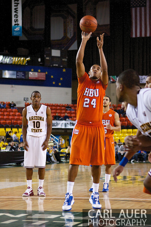 November 25th, 2010:  Anchorage, Alaska - Terry Bembry (24), a forward for Houston Baptist shoots a free throw in the Huskies 55-73 loss to the Arizona State Sun Devils at the Great Alaska Shootout.