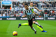 Miguel Almiron (#24) of Newcastle United scampers after the loose ball during the Premier League match between Newcastle United and Huddersfield Town at St. James's Park, Newcastle, England on 23 February 2019.