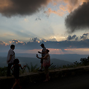 A family takes pictures of themselves with yesterday's sunset from an overlook along skyline drive in Shenandoah national park.