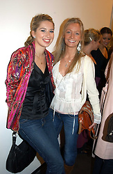 Left to right, ALEX FINLAY and MARTHA WARD at an exhibition of photographs by Matthew Mellon entitled Famous Feet - featuring well known people wearing shoes from Harrys of London, held at Hamiltons Gallery, Carlos Place, London on 22nd November 2004.<br />