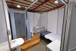 JOHANNESBURG, SOUTH AFRICA - APRIL 25: An isolation unit at the Nasrec quarantine site currently under construction. With isolation units, consultation areas, ICU capabilitiies, medical facilities, power points, drainage and ablutions the quarantine site has a total bed capacity of 2300 on April 25, 2020 in Johannesburg South Africa. Under pressure from a global pandemic. President Ramaphosa declared a 21 day national lockdown extended by another two weeks, mobilising goverment structures accross the nation to combat the rapidly spreading COVID-19 virus - the lockdown requires businesses to close and the public to stay at home during this period, unless part of approved essential services. (Photo by Dino Lloyd)
