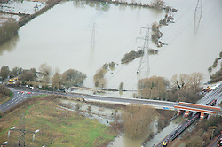 © Licensed to London News Pictures. 09/01/2014. Oxford, UK. A train on flooded railway tracks and electricity pylons at Hinksey. Flooding in Oxford today 9th January 2014. Persistent rainfall across the UK, including in Oxford, has led to rising water levels on rivers. Photo credit : Air Experiences/LNP