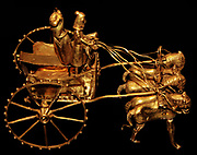 Ceremonial chariots. Oxus treasure. Horses pulling two people in Median dress. Persian. Iran, 500–300 BC.