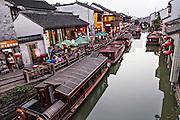 Boats wait for passengers along Shantang canal in Suzhou, China.