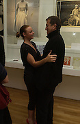Stella McCartney and Mario Testino. Private view for Unseen Vogue, Design museum. 31 November 2002. © Copyright Photograph by Dafydd Jones 66 Stockwell Park Rd. London SW9 0DA Tel 020 7733 0108 www.dafjones.com