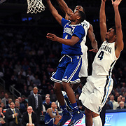 Sterling Gibbs, Seton Hall, drives to the basket  during the Villanova Wildcats Vs Seton Hall Pirates basketball game during the Big East Conference Tournament at Madison Square Garden, New York, USA. 12th March 2014. Photo Tim Clayton