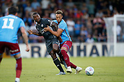 Kyle Wootton Of Scunthorpe United challenges Wes Morgan of Leicester City during the Pre-Season Friendly match between Scunthorpe United and Leicester City at Glanford Park, Scunthorpe, England on 16 July 2019.