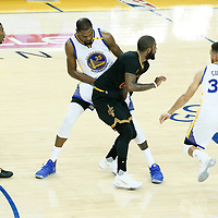 04 June 2017: Golden State Warriors guard Stephen Curry (30) drives past Cleveland Cavaliers guard Kyrie Irving (2) on a screen set by Golden State Warriors forward Kevin Durant (35) during the Golden State Warriors 132-113 victory over the Cleveland Cavaliers, in game 2 of the 2017 NBA Finals, at the Oracle Arena, Oakland, California, USA.