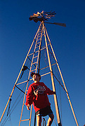 Adam in front of windmill