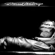 NASCAR legend Darrell Waltrip takes a look outside his car. (Photo by Travis Bell) ©2014
