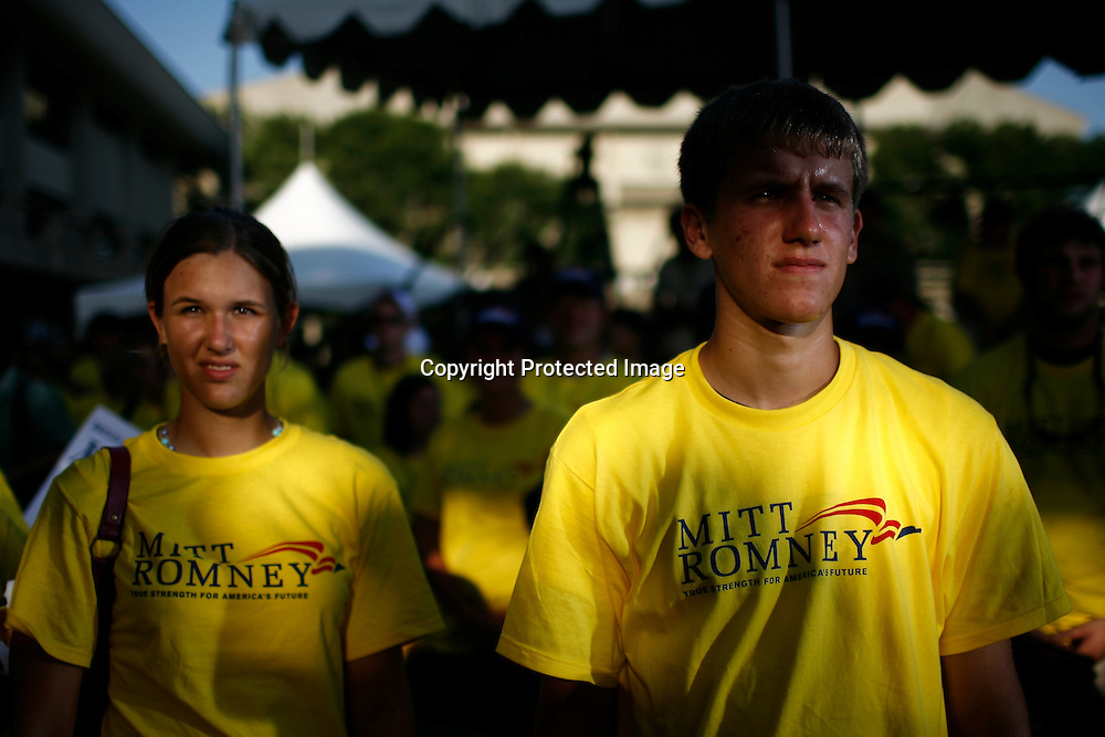 Supporters of U.S. Presidential candidate Mitt Romney wait for the results of the Iowa State Straw Poll August 11, 2007 in Ames, Iowa.