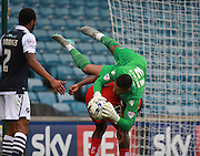 Millwall player Jordan Archer catches the ball over the shoulder of Chesterfield player Sylvan Ebanks-Blake during the Sky Bet League 1 match between Millwall and Chesterfield at The Den, London, England on 29 August 2015. Photo by Bennett Dean.