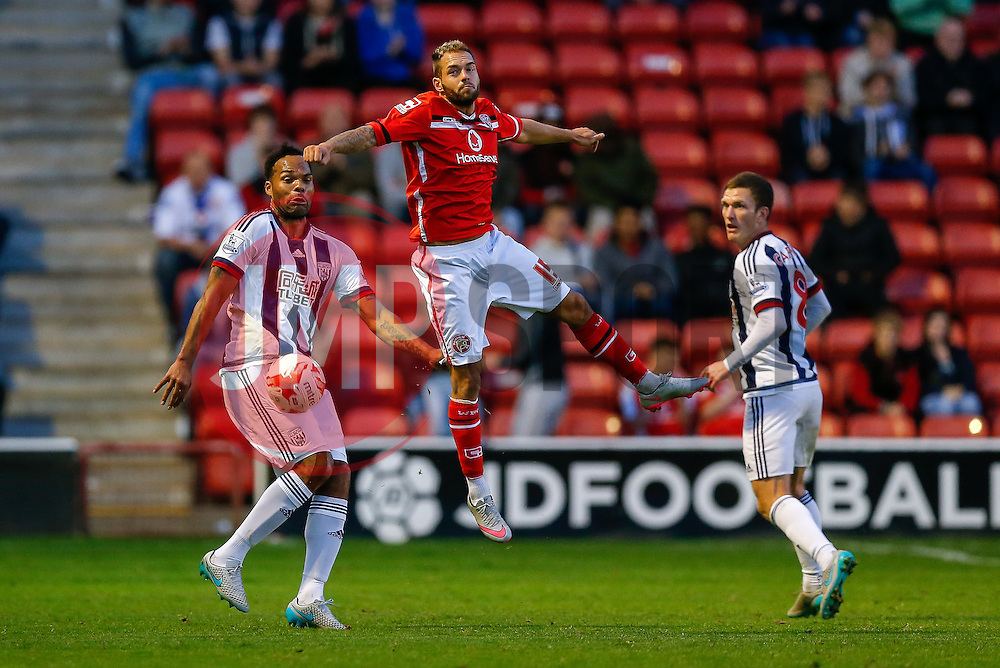 Joleon Lescott of West Brom and Milan Lalkovic of Walsall compete in the air - Mandatory byline: Rogan Thomson/JMP - 07966 386802 - 28/07/2015 - SPORT - Football - Walsall, England - Besot Stadium - Walsall v West Bromwich Albion - 2015/16 Pre Season Friendly.