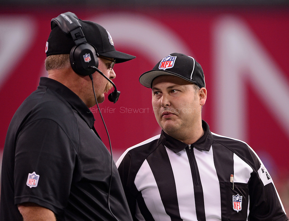 Sept. 23, 2012; Glendale, AZ, USA; Philadelphia Eagles head coach Andy Reid talks with NFL side official Kevin Peloquin (78) in the first half at University of Phoenix Stadium. Mandatory Credit: Jennifer Stewart-US PRESSWIRE.