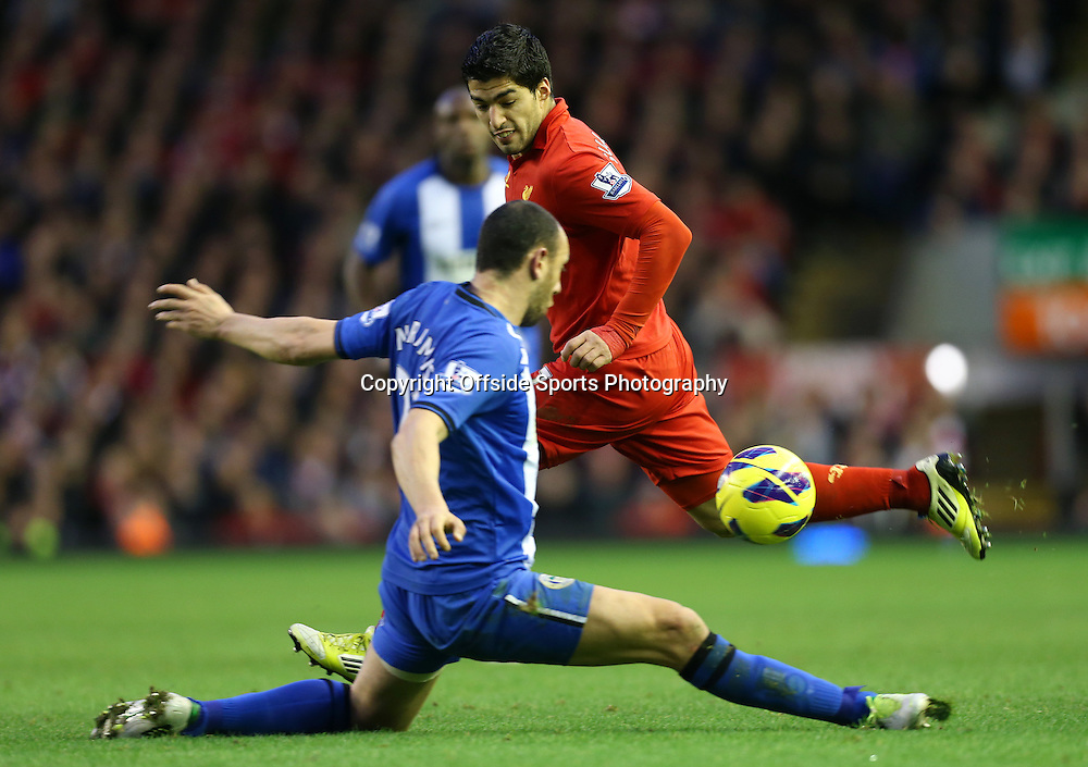 17th November 2012 - Barclays Premier League - Liverpool vs. Wigan Athletic - Ivan Ramis of Wigan blocks a pass from Luis Suarez of Liverpool - Photo: Simon Stacpoole / Offside.