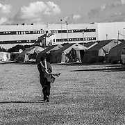 A migrant farmhand in the tent camp of San Fardinando, Rosarno. Most of the people arrived in Italy because of the libian war in 2011, so they are refugees or waiting for political asylum. Some of them are irregular