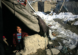 An Afghan refuge child sits under a tent at a refugee camp, Kabul, Afghanistan, January 2, 2013. Photo by Imago / i-Images...UK ONLY