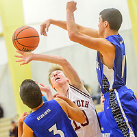Mancos Blue Jays Adrian Hernandez (3), left, and Andrew Plunkett (11) surround  Rehoboth Lynx Lance McMullin (10) during the Rehoboth Christian boys basketball tournament at Rehoboth High School Thursday.