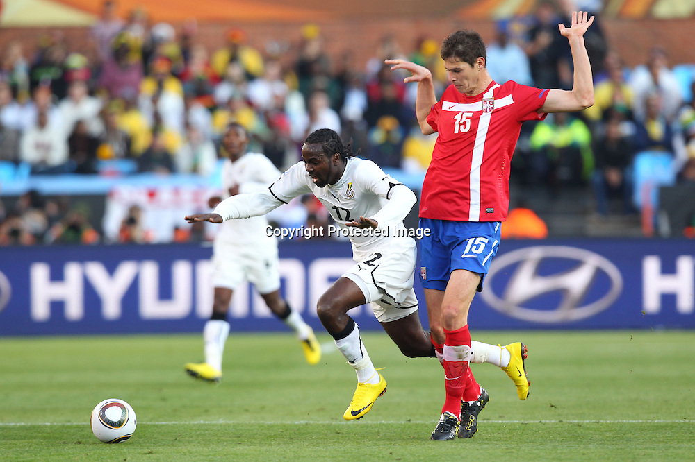 (L to R) <br /> Prince Tagoe (GHA), <br /> Nikola Zigic (SRB), <br /> JUNE 13, 2010 - Football : <br /> 2010 FIFA World Cup South Africa <br /> Group Match -Group D- <br /> between Serbia 0-1 Ghana <br /> at Loftus Versfeld Stadium, Pretoria, South Africa. <br /> (Photo by YUTAKA/AFLO SPORT) [1040]