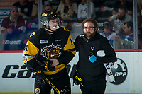 REGINA, SK - MAY 22: Will Bitten #14 of Hamilton Bulldogs heads to the bench with athletic therapist JP Laciak against the Acadie-Bathurst Titan at the Brandt Centre on May 22, 2018 in Regina, Canada. (Photo by Marissa Baecker/CHL Images)