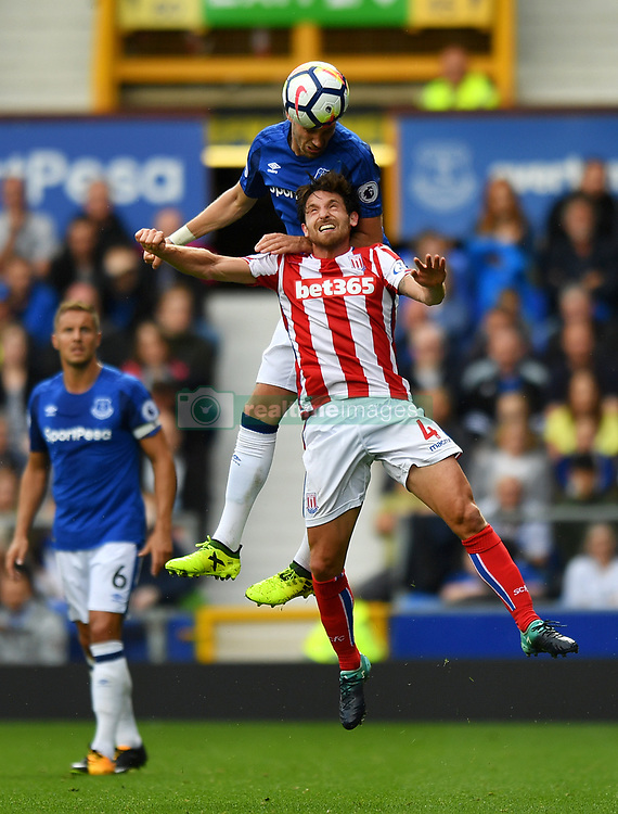 Stoke City's Joe Allen (right) and Everton's Morgan Schneiderlin battle for the ball during the Premier League match at Goodison Park, Liverpool.