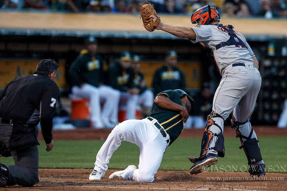 OAKLAND, CA - JULY 19:  Marcus Semien #10 of the Oakland Athletics is tagged out at home plate by Evan Gattis #11 of the Houston Astros in front of umpire Manny Gonzalez #79 during the second inning at the Oakland Coliseum on July 19, 2016 in Oakland, California. The Oakland Athletics defeated the Houston Astros 4-3 in 10 innings.  (Photo by Jason O. Watson/Getty Images) *** Local Caption *** Marcus Semien; Evan Gattis; Manny Gonzalez